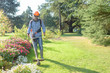 utility worker with brush cutting for remove grass