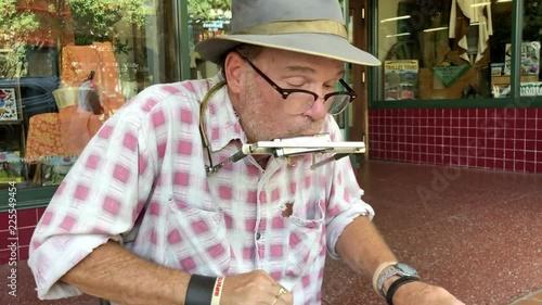 Street performer playing music on sidewalk