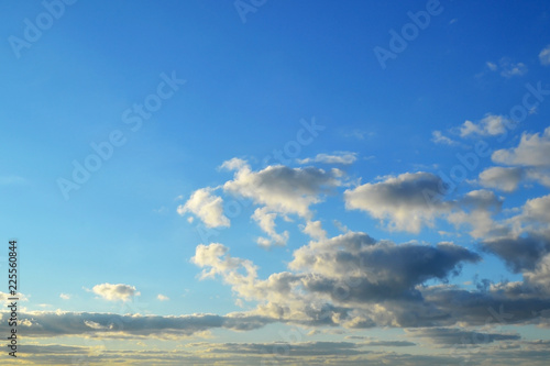 Foto Murales Light white clouds high in a blue sky on a sunny day background