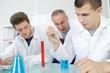 Teacher supervising science experiment