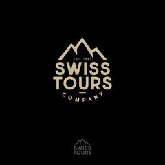 Mountains peaks and letters. Swiss Tours Company logo. Gold emblem for alpinism, ski resort or mountain tourism.