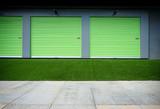 roll up green doors on modern building - 225636674