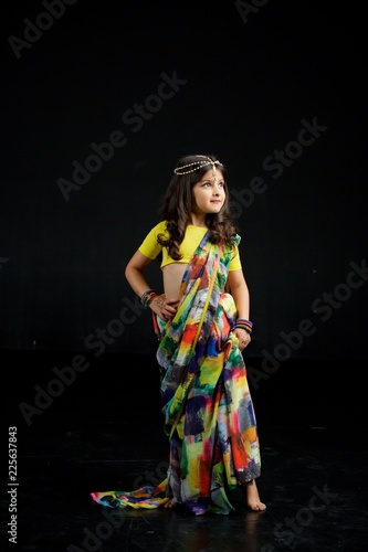 Foto Murales Little baby girl, dressed in a Sari of Indian culture.
