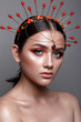 Beautiful girl with creative colorful make up. Beauty face. Photos shot in studio