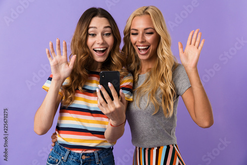 Leinwandbild Motiv Two pretty cheerful young girls friends