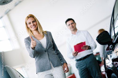 Leinwanddruck Bild Picture of professional salesperson working in car dealership