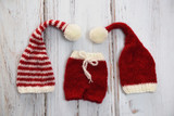 Handmade elf hats and shorts in Christmas colors - 225691066