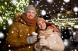 Leinwandbild Motiv winter holidays, hot drinks and people concept - happy young couple with coffee at christmas market in evening