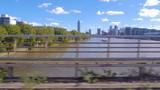 Crossing river Thames. On Battersea Bark Bridge. Thames view into London Skyline. Slow motion. - 225704845