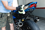 A man cleaning motorcycle with cloth. Selective focus. - 225715226