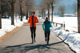 Two people jogging in the winter