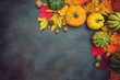 Autumn background with colorful leaves and pumpkins