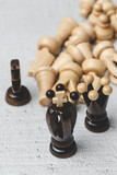 Game and chess pieces on white background