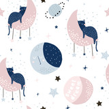 Seamless childish pattern with cats on moons and starry sky. Creative kids texture for fabric, wrapping, textile, wallpaper, apparel. Vector illustration - 225751269