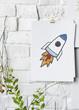 Leinwandbild Motiv Rocket launch drawing on a paper poster on white wall