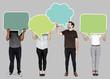 Leinwanddruck Bild - People holding colorful speech bubbles