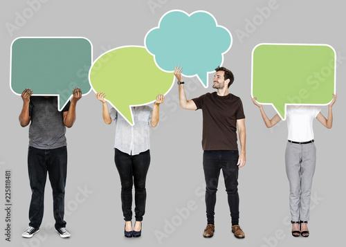 Leinwanddruck Bild People holding colorful speech bubbles