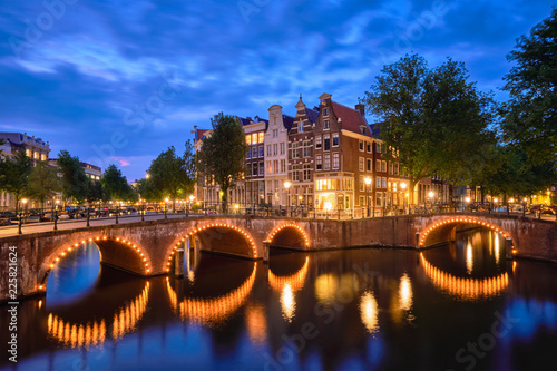 Wall mural Amterdam canal, bridge and medieval houses in the evening