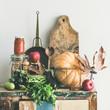 Leinwanddruck Bild - Autumn seasonal food ingredients, kitchen utensils. Vegetables, pumpkin, apples, canned food, fallen leaves over rustic chest of cupboard, copy space, square crop. Thanksgiving dinner preparation