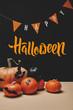 "Leinwanddruck Bild - pumpkins, paper bats and paper garland with ""happy halloween"" lettering"