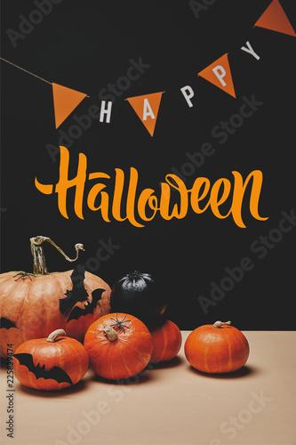 "Leinwanddruck Bild pumpkins, paper bats and paper garland with ""happy halloween"" lettering"