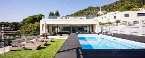 Giant balcony of modern apartment with swimming pool on a summer day