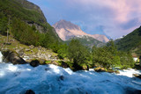 Waterfall over the Geiranger fjord - 225835229