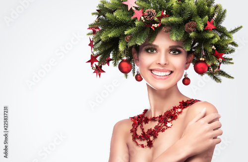 Leinwanddruck Bild Smiling Beauty Fashion Model Girl with Fir Branches Decoration Isolated