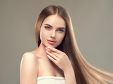 Woman with long brunette smooth hair shine and beauty hairstyle