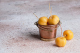 Yellow paradise apples in a vintage copper bucket - 225882084