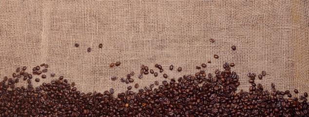 coffee beans, border on a jute background © alexanderbaumann