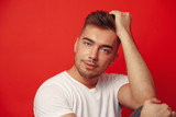 Studio Man Fashion Portrait on Red Background  - 225885038