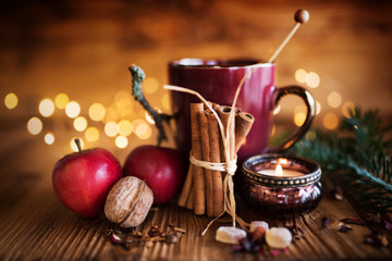 Decoration in winter with candle and tea