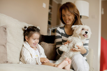 Mother and little girl with dog in the room © Boggy