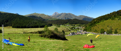 paragliders and Pic du Midi de Bigorre at background