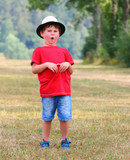 Little boy making a funny grimace. Humor and fun during summer vacations. - 225917823