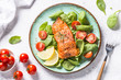 Leinwanddruck Bild - Baked salmon fish fillet with fresh salad top view.