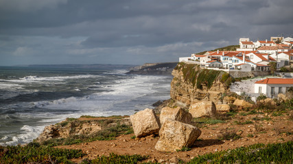 Azenhas do Mar, beautiful village in the municipality of Sintra, built on a cliff-top, overlooking the Atlantic Ocean, Portugal. Travel Europe. © Telly