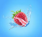 raspberry in water splash on a blue background