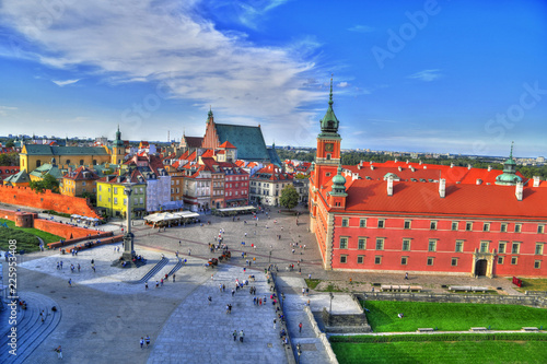 Beautiful colorful HDR aerial image of the famous Old town in Warsaw, Poland. The Royal Castle and Sigismund's Column called Kolumna Zygmunta on blue dramatic sky
