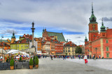 Beautiful colorful HDR image of the tourists at the famous Old town in Warsaw, Poland. The Royal Castle and Sigismund's Column called Kolumna Zygmunta, Warsaw, Poland