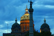 The Iowa State Capitol dome is illuminated behind the Soldiers and Sailors Monument. The Capitol building was completed in 1886 and the Monument was completed in 1896.