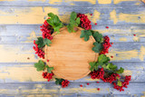 viburnum on a wooden background,an empty plate for text - 225966864