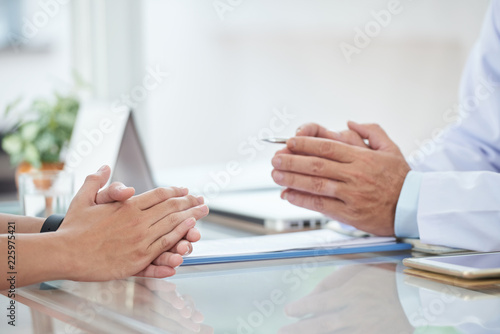 Hands of doctor and patient during conversation