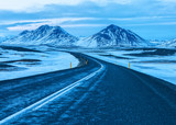 Road to the snow-capped mountains at twilight in winter.   .  The Ring Road  (Route 1) of Iceland, between Egilsstadir and  Akureyri. . Natural landscape in Northeast of Iceland. - 225998203
