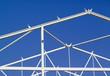 white building frame against blue sky