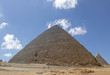 The Great Pyramid of Giza (also known as the Pyramid of Khufu or the Pyramid of Cheops) is the oldest and largest of the three pyramids in the Giza pyramid complex.