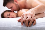 Couple Being Intimate On Bed