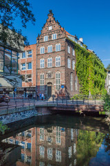 GDANSK, POLAND - SEPTEMBER 1, 2016: Reflection of a brick house in a canal in Gdansk, Poland
