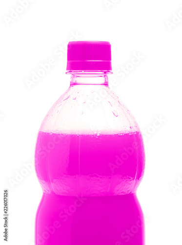 A bottle with tasty drink isolated on background - 226017026